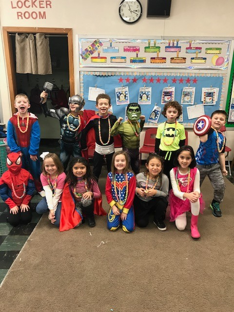 "SEDALIA: Sacred Heart School students in Mrs. Zoey Plummer's first grade celebrate the 100th day of school by dressing like their favorite superheroes and making Fruit Loop necklaces. The ""dress like your favorite super hero day"" was part of the school's Catholic Schools Week observance."