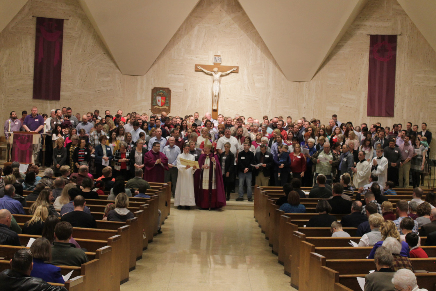 Candidates for full communion with the Catholic Church gather with their sponsors in the in the sanctuary of the Cathedral of St. Joseph in Jefferson City during the Rite of Election and Call to Continuing Conversion on Feb. 18.