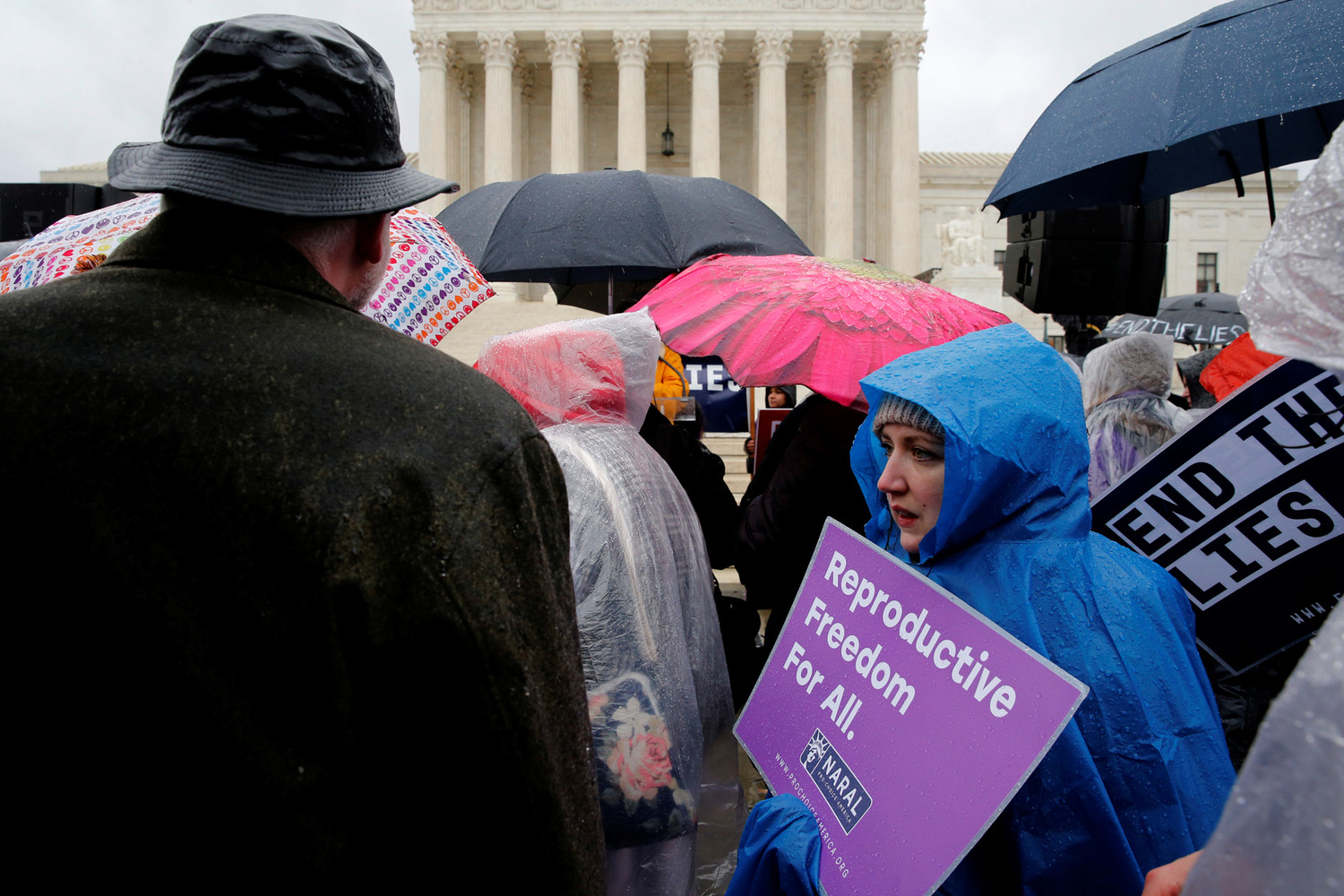 Pro-life advocates and a counter-demonstrator gather March 20 outside the U.S. Supreme Court in Washington as the court hears oral arguments in NIFLA v. Becerra, a case about freedom of speech at crisis pregnancy centers.