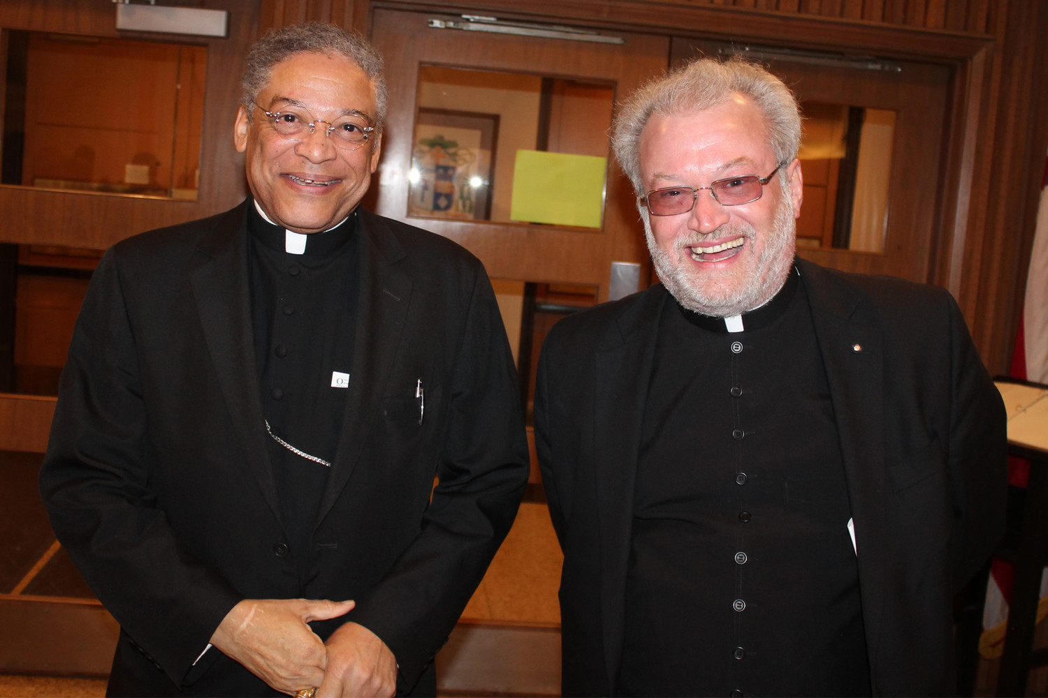 Bishop Joseph N. Perry, auxiliary bishop of Chicago and diocesan postulator for Servant of God Father Augustus Tolton's beatification cause, visits with Father Michael W. Penn, pastor of Holy Rosary parish in Monroe City and St. Stephen parish in Indian Creek, who is the Jefferson City diocese's representative to the Fr. Tolton Guild.