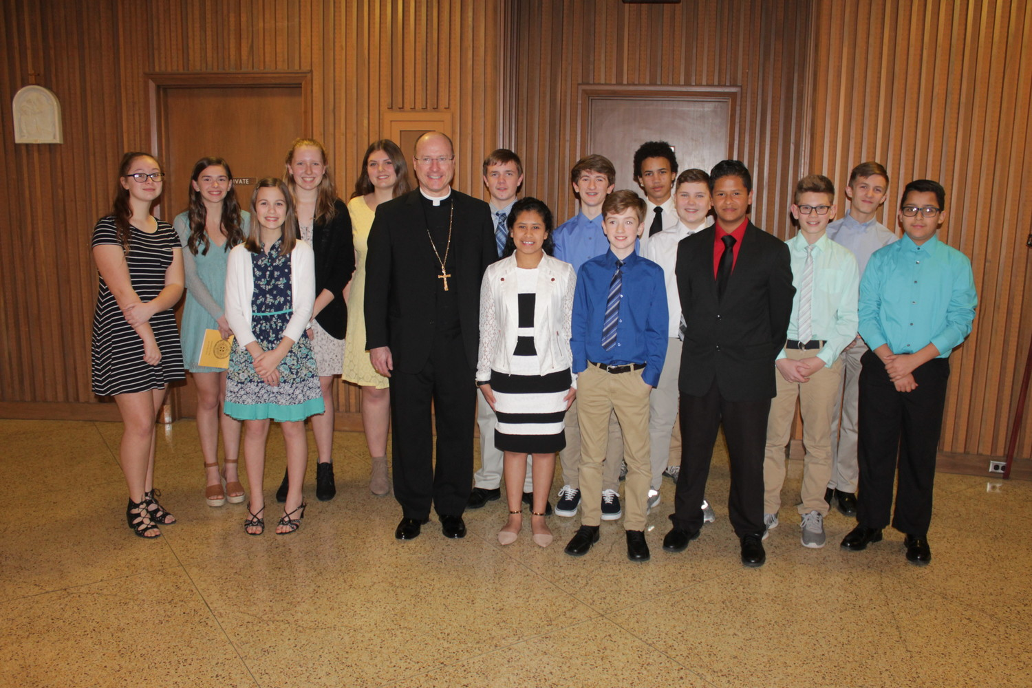 Students from Sacred Heart High School in Sedalia gather for a photo with Bishop W. Shawn McKnight after the Chrism Mass in the Cathedral of St. Joseph.