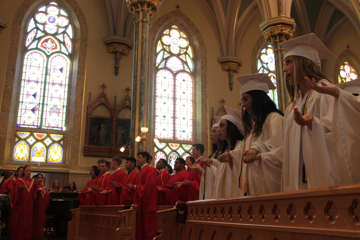 The 33 members of the Class of 2018 of Sacred Heart High School in Sedalia worship God together for the last time as a students of the school during their Baccalaureate Mass May 11 in Sacred Heart Church.