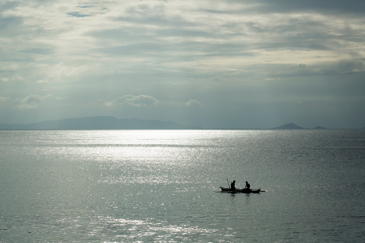 In this 2014 file photo, fishermen are seen in a boat near Guiuan, Philippines. To date, the social action arm of the Catholic Church has been able to help about 1.8 million people affected by the destruction brought by Typhoon Haiyan that struck the central Philippines in 2013.