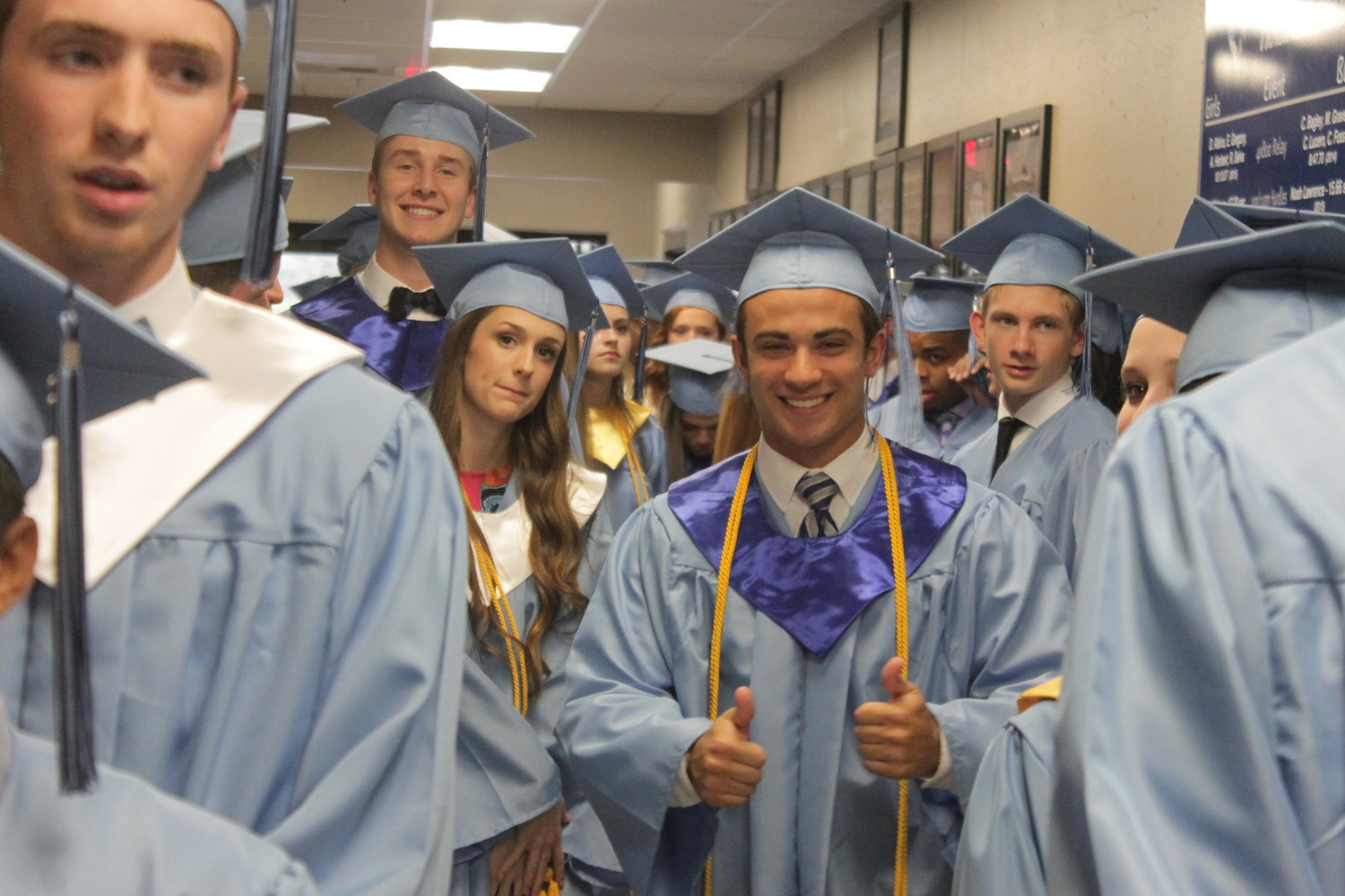 Members of Fr. Tolton Regional High School's graduating Class of 2018 line up in the hallway right before their commencement ceremony begins.