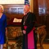 Callista Gingrich, U.S. ambassador to the Vatican, and Archbishop Jean-Luis Brugues, librarian of the Vatican Library, pose in front of a copy of a letter written by Christopher Columbus during a ceremony at the Vatican June 14. The United States tracked down and returned a stolen copy of the Columbus letter, an account of the explorer's discovery of America written in 1493.