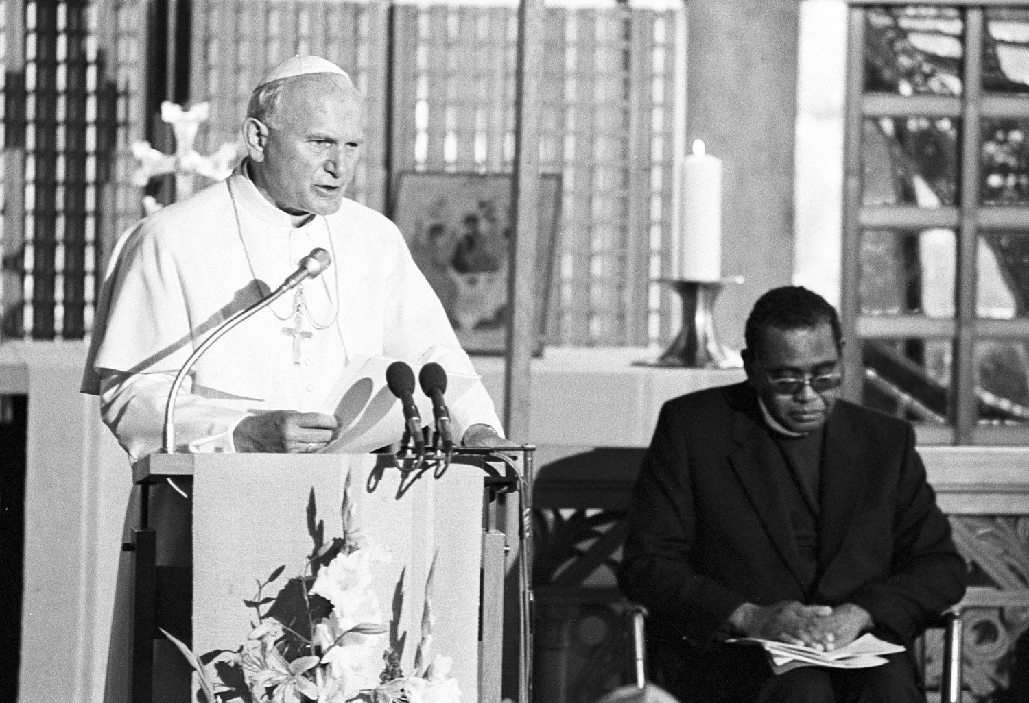 Pope St. John Paul II speaks during a visit to the World Council of Churches in Geneva June 12, 1984. Also pictured is the Rev. Philip Potter, general secretary of the WCC. Pope Francis is scheduled to attend an ecumenical prayer service and meeting at the WCC during a one-day visit to Geneva June 21.
