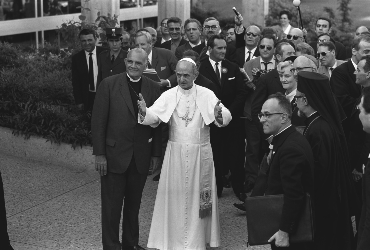 Blessed Pope Paul VI stands next to Eugene C. Blake, general secretary of the World Council of Churches, as he arrives at the headquarters of the WCC in Geneva June 10, 1969. Pope Francis is scheduled to attend an ecumenical prayer service and meeting at the WCC during a one-day visit to Geneva June 21.