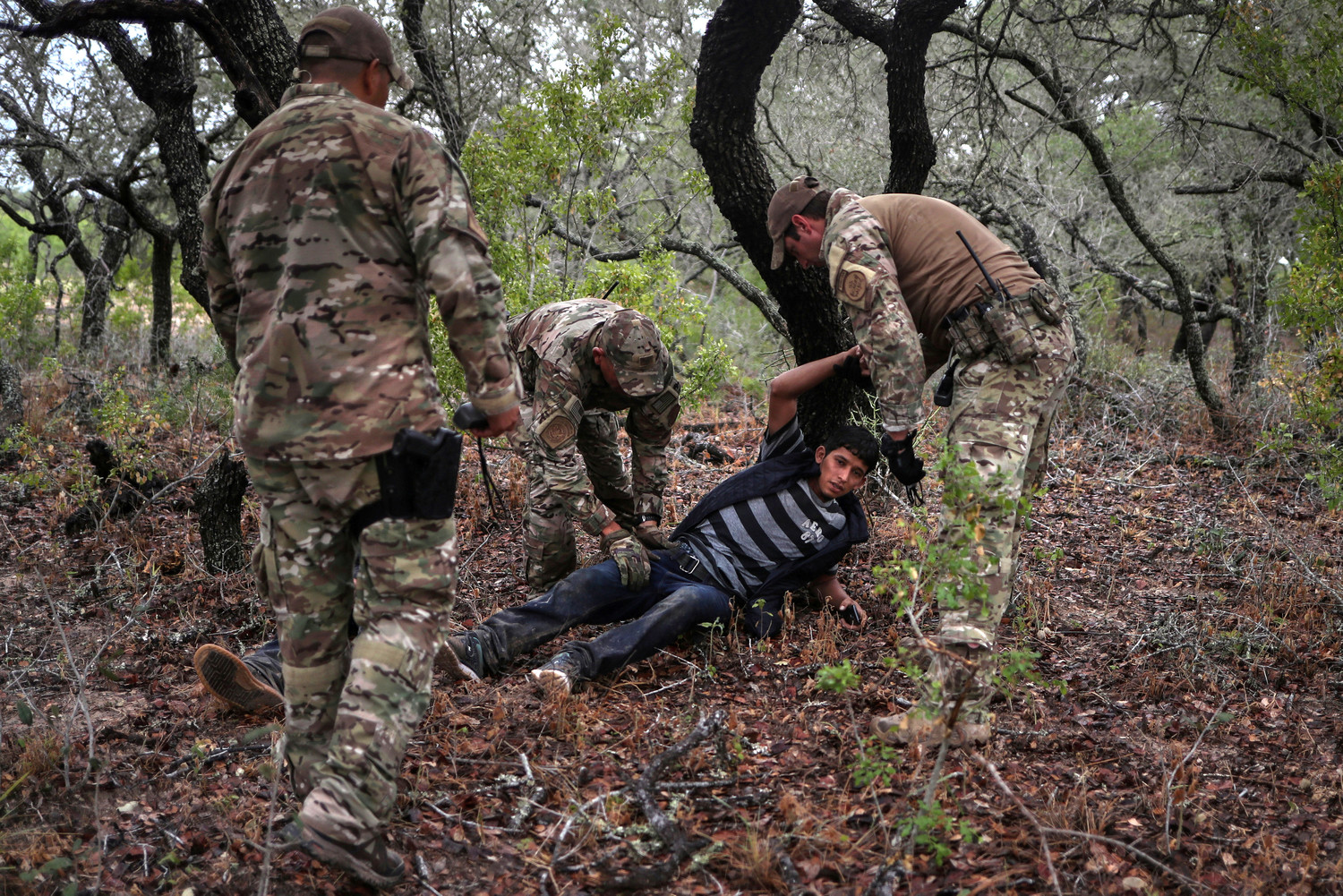 Members of the Border Patrol Search, Trauma, and Rescue Unit near Falfurrias, Texas, apprehend an injured immigrant from Honduras June 19. Pope Francis told Reuters he stands with the U.S. bishops in their condemnation of the Trump administration's immigration policy has led to children being held in government shelters while their parents are detained in federal prison.
