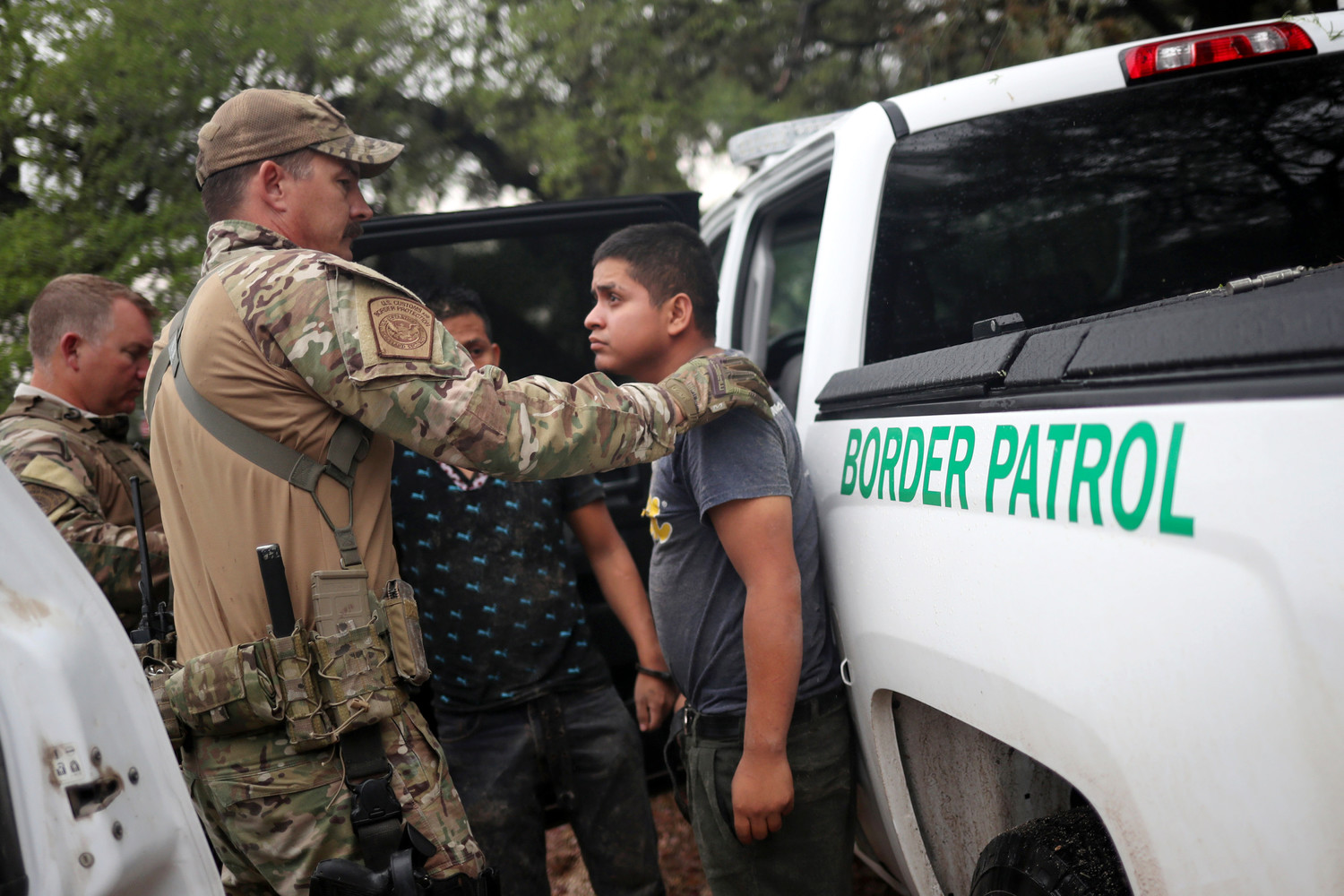 Members of the Border Patrol Search, Trauma, and Rescue Unit near Falfurrias, Texas, apprehend an immigrant from Guatemala June 19. Pope Francis told Reuters he stands with the U.S. bishops in their condemnation of the Trump administration's immigration policy has led to children being held in government shelters while their parents are detained in federal prison.