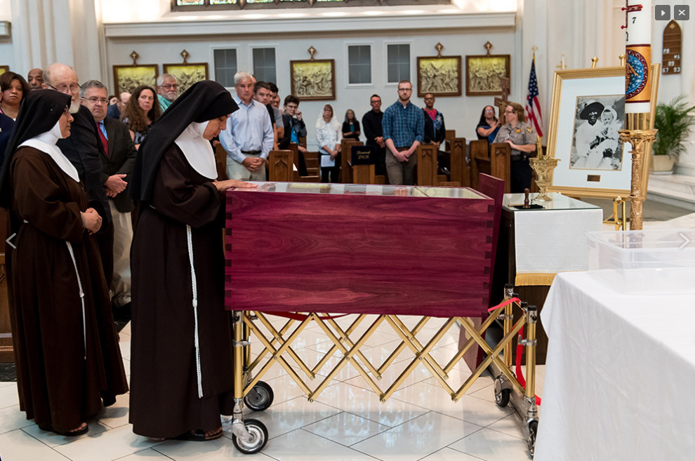 Members of the congregation venerate the mortal remains of Servant of God Julia Greeley during the Transfer of the Remains Ceremony at the Cathedral Basilica of the Immaculate Conception in Denver on June 7 of last year.