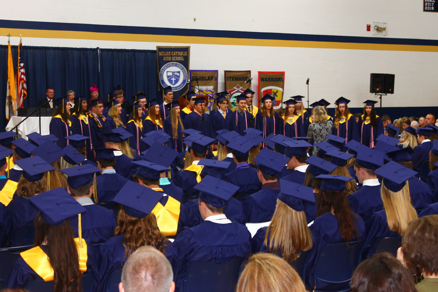 Members of Helias Catholic High School's Class of 2018 sing their class song during their graduation on May 20.