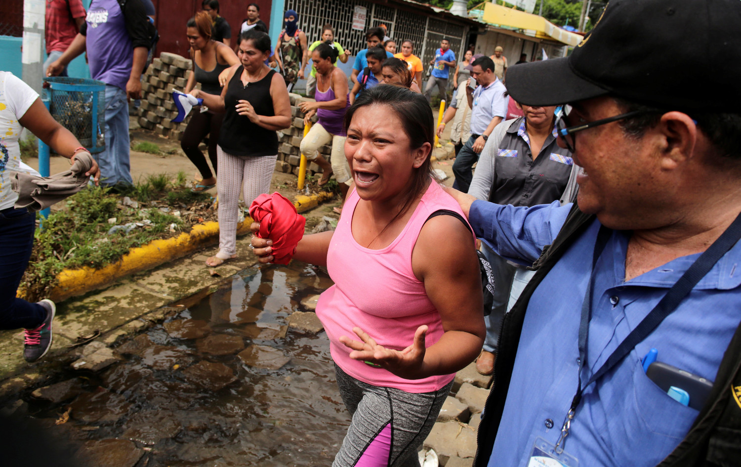 A woman reacts during the arrival of Catholic leaders as anti-government protests continue in Masaya, Nicaragua, June 21.