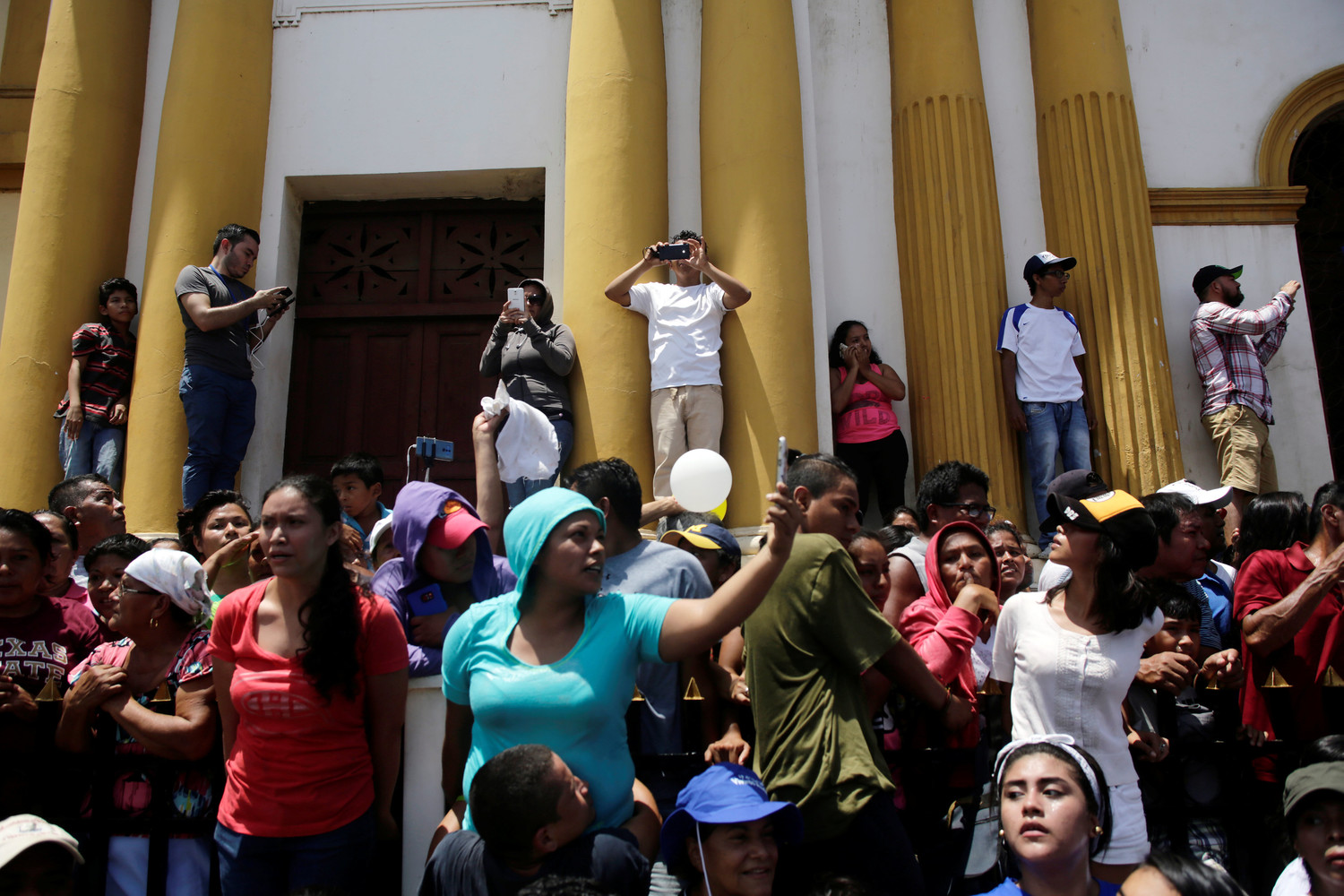 People react during the arrival of Catholic leaders as anti-government protests continue in Masaya, Nicaragua, June 21.