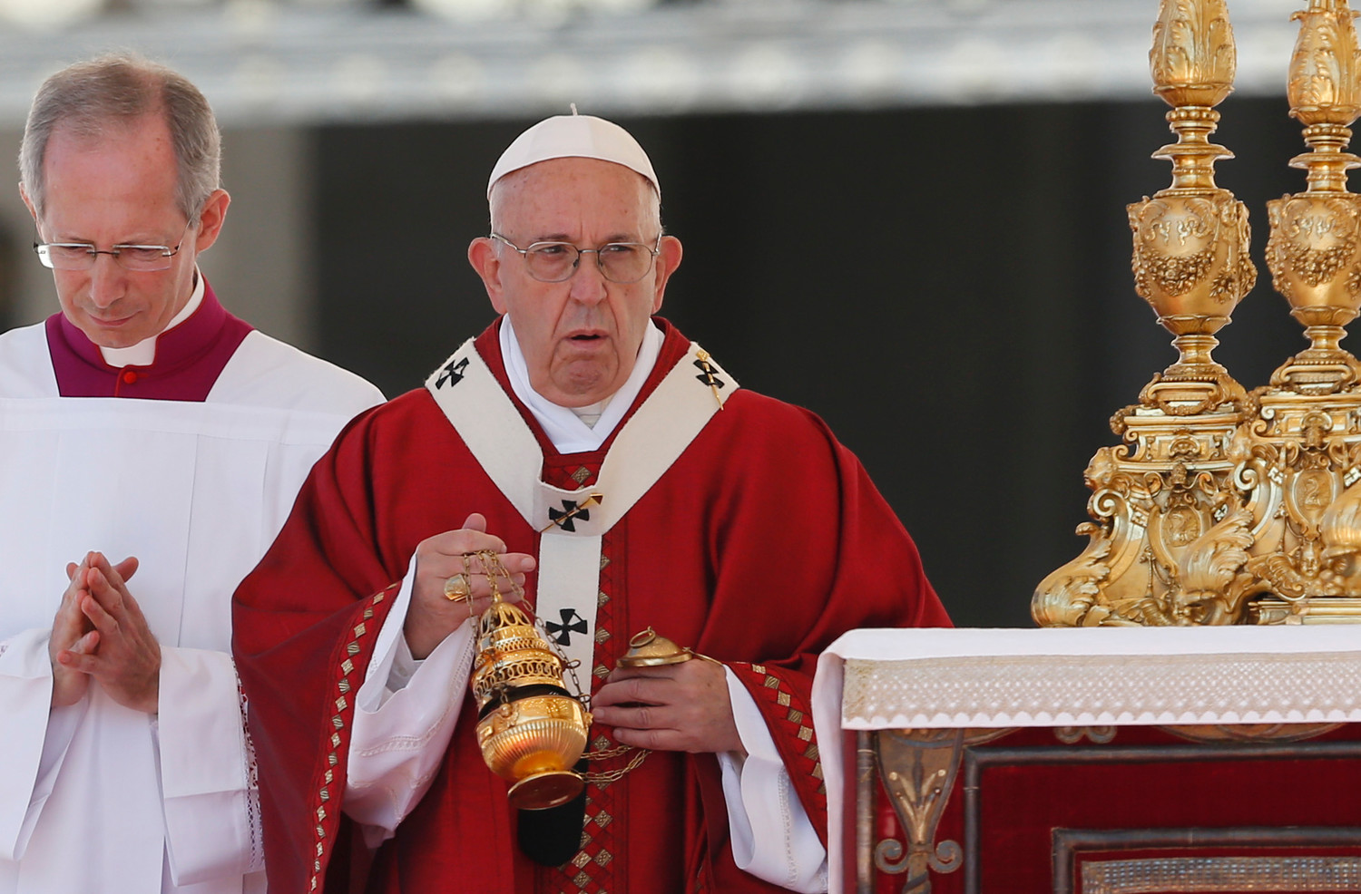 Pope Francis uses incense as he celebrates Mass marking the feast of Saints Peter and Paul in St. Peter's Square at the Vatican June 29. At the conclusion of the Mass the Pope presented palliums in boxes to dozens of new archbishops from around the world.