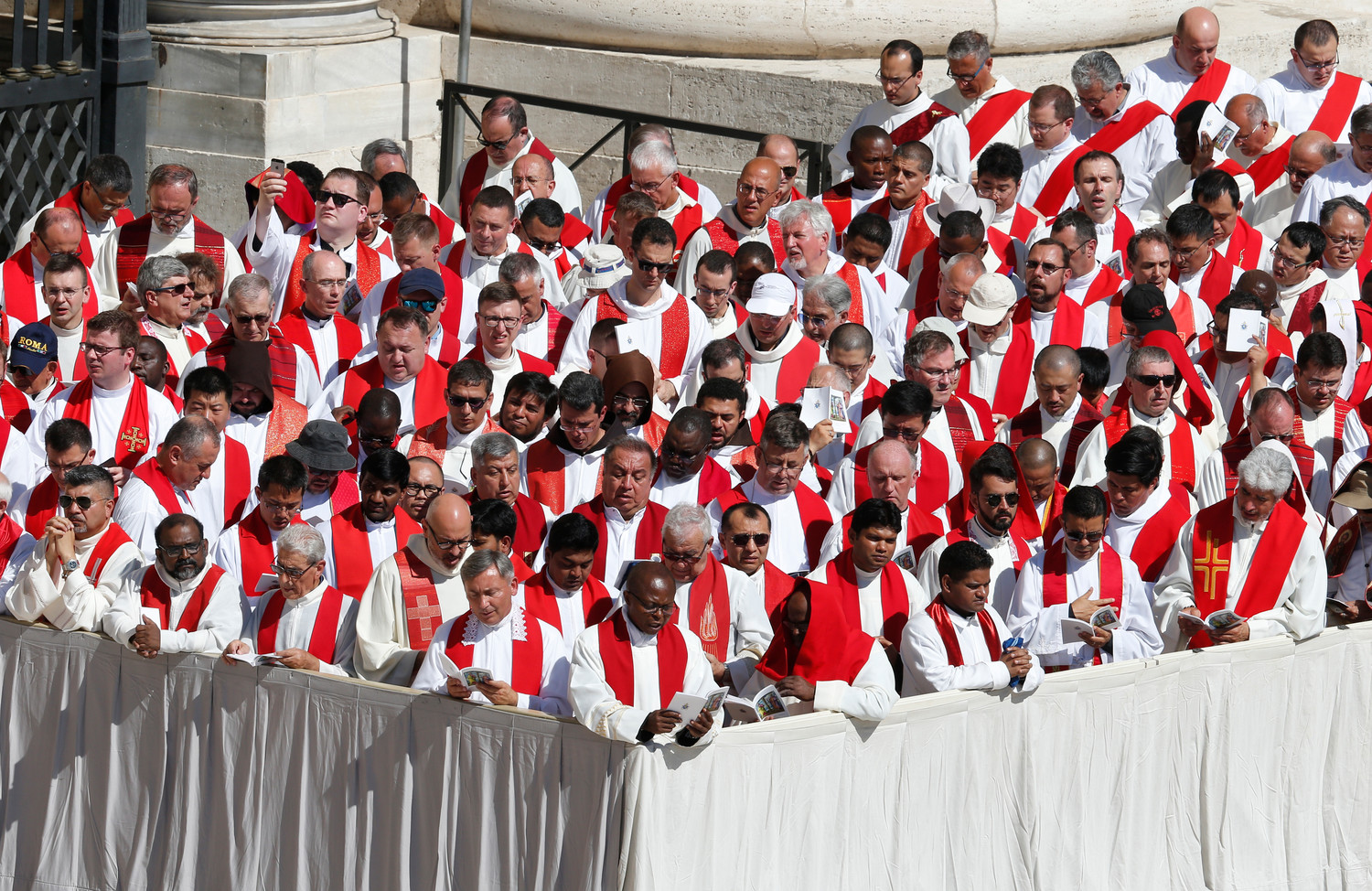 Priests attend Pope Francis' celebration of Mass marking the feast of Saints Peter and Paul in St. Peter's Square at the Vatican June 29. At the conclusion of the Mass the Pope presented palliums in boxes to dozens of new archbishops from around the world.