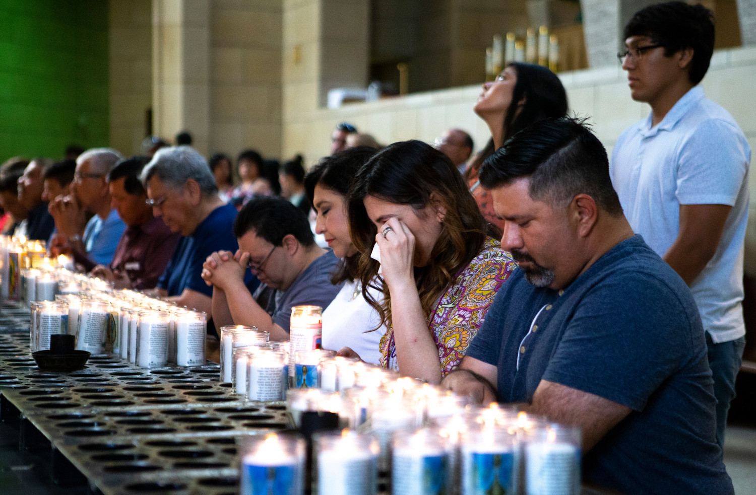 Worshipers pray before a July 1 Mass at the Basilica of Our Lady of San Juan del Valle in San Juan, Texas. A delegation of U.S. bishops concelebrated the Mass at the beginning of their fact-finding mission about Central American immigrant detention at the U.S.-Mexican border.