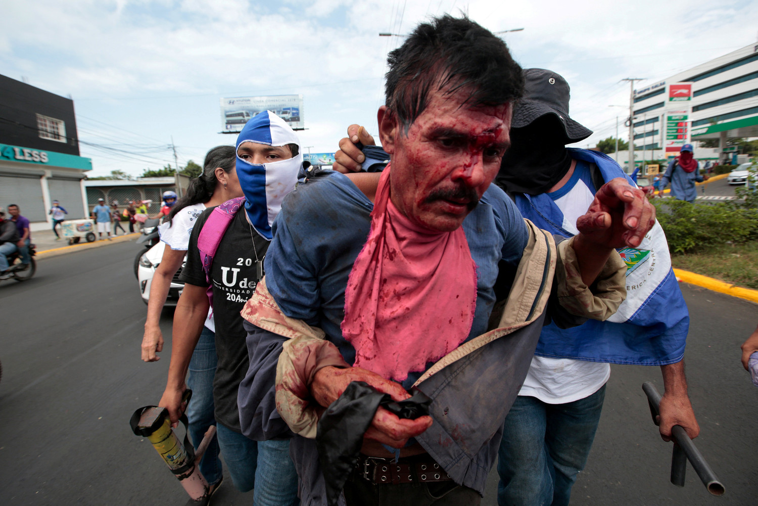 Protesters capture an injured man suspected of being a collaborator of Nicaraguan President Daniel Ortega's government after a June 30 protest in Managua. Cardinal Leopoldo Brenes Solorzano of Managua was among Nicaraguan bishops and clergy attacked by armed groups aligned with the government July 9 in the city of Diriamba.