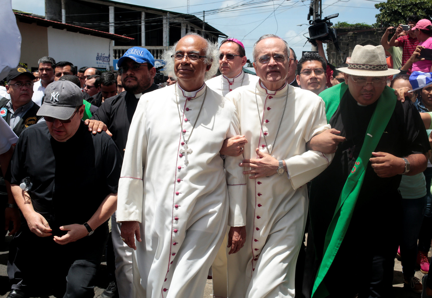 Cardinal Leopoldo Brenes Solorzano of Managua, Nicaragua, and Auxiliary Bishop Silvio Baez Ortega, arrive as anti-government protests continue July 9 in Diriamba. Later that day the two prelates were among Nicaraguan bishops and clergy attacked by armed groups aligned with the government Diriamba.