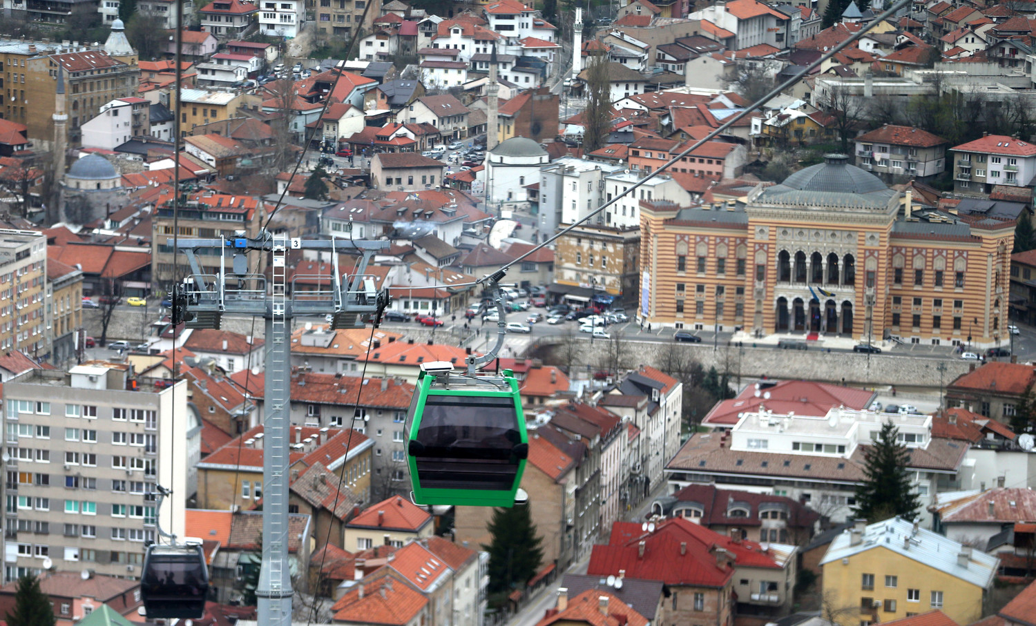 "The Trebevic cable car is seen above the city of Sarajevo, Bosnia-Herzegovina, in early April. The world needs leaders who can ""put into practice a more just way for all of us to live in this world as sharers in a common destiny,"" Pope Francis said in a letter to the international conference of ""Catholic Theological Ethics in the World Church,"" gathering in Sarajevo July 26-29."