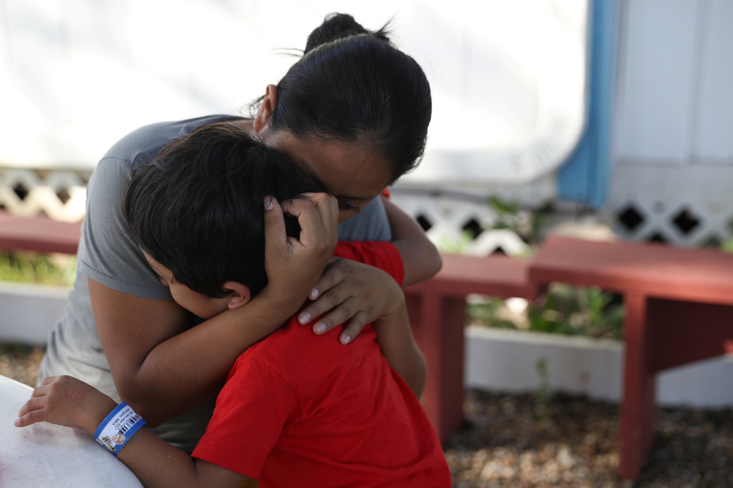Anita Areli Ramirez Mejia, an asylum seeker from Honduras, hugs her 6-year-old son, Jenri, July 13 at La Posada Providencia shelter in San Benito, Texas. The mother and son were reunited after being separated near the Mexico-U.S. border.