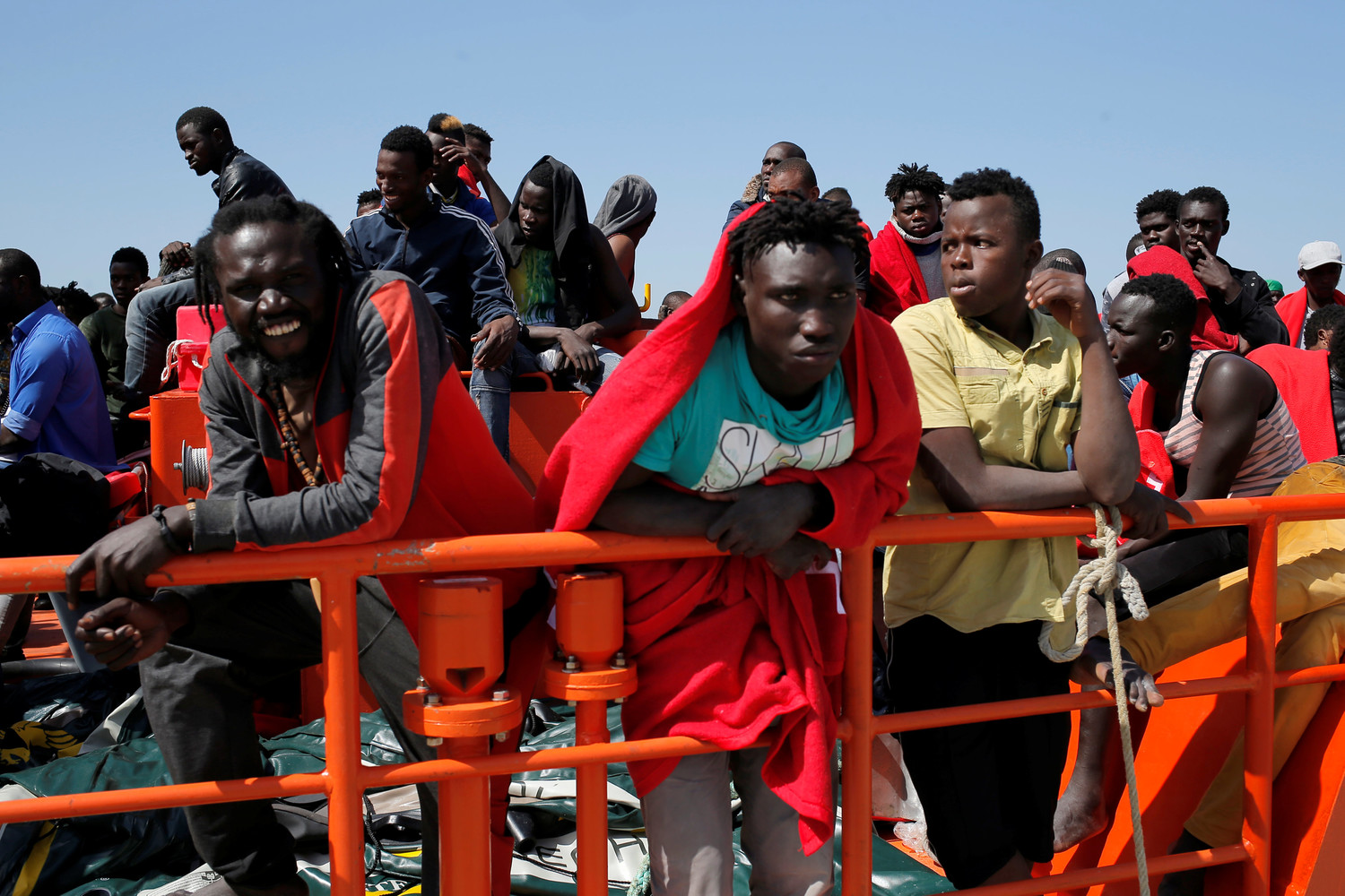 Migrants, intercepted aboard a makeshift boat in the Mediterranean Sea, are seen after arriving on a rescue boat July 22 at the Spanish port of Algeciras.