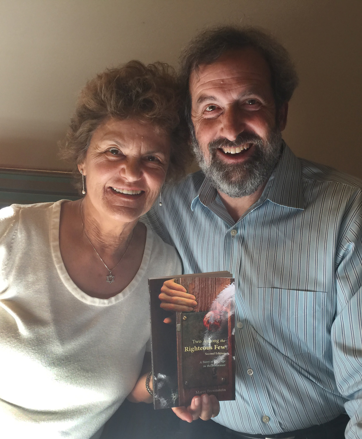 "Marty Brounstein, author of ""Two Among the Righteous Few: A Story of Courage in the Holocaust,"" poses in early April with his wife, Leah Baars."