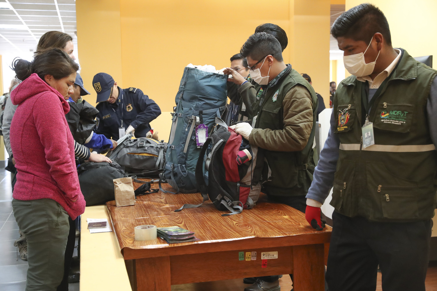 Bolivian and Peruvian customs officers check tourists' luggage in late April at the Binational Border Attention Center of Peru and Bolivia in Desaguadero, Peru.