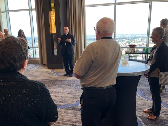 Bishop W. Shawn McKnight attends an informal gathering with deacons of the Jefferson City diocese during the National Diaconate Congress in New Orleans.