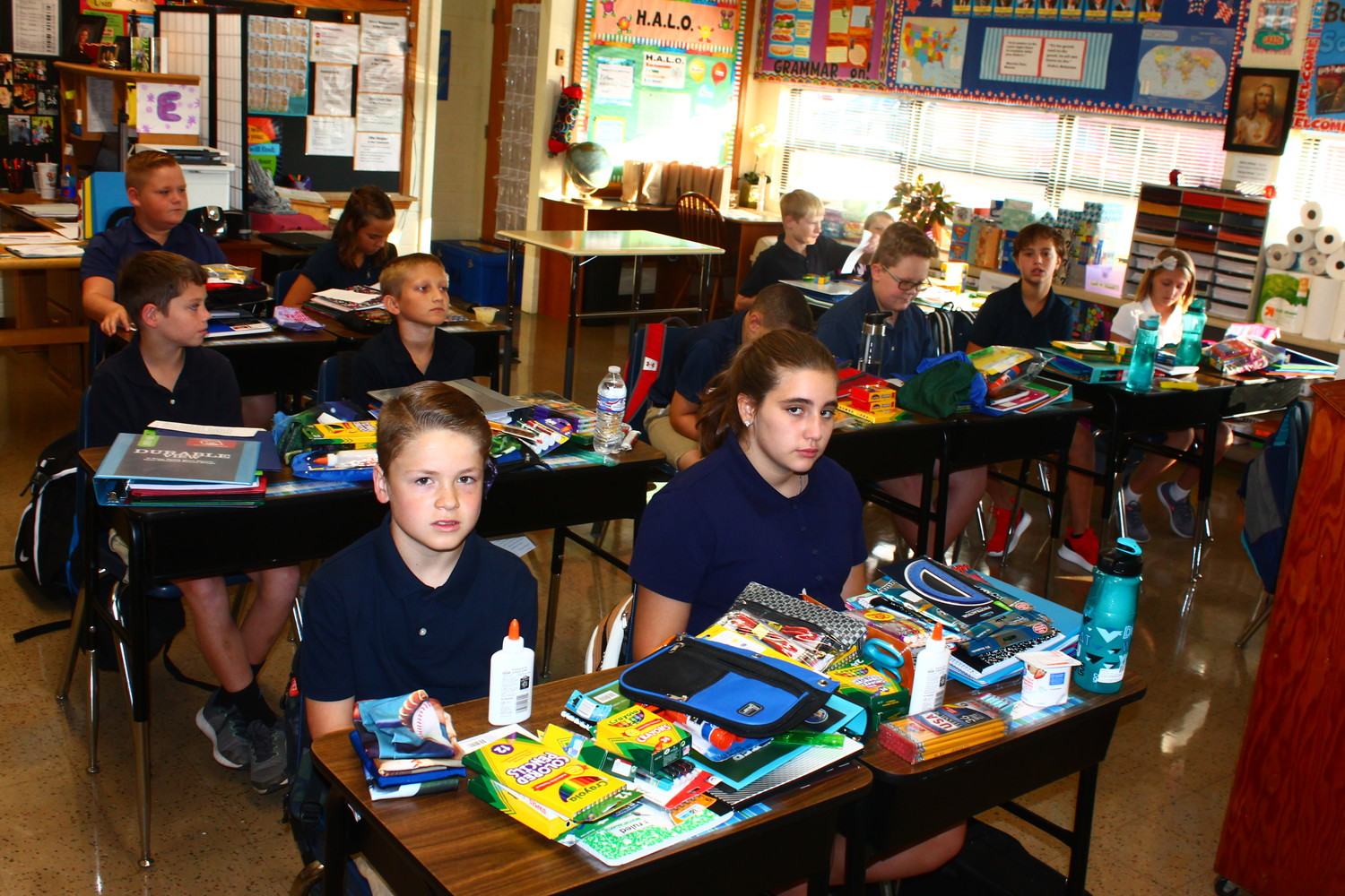 Students of Immaculate Conception School in Jefferson City make the transition from summer to school.