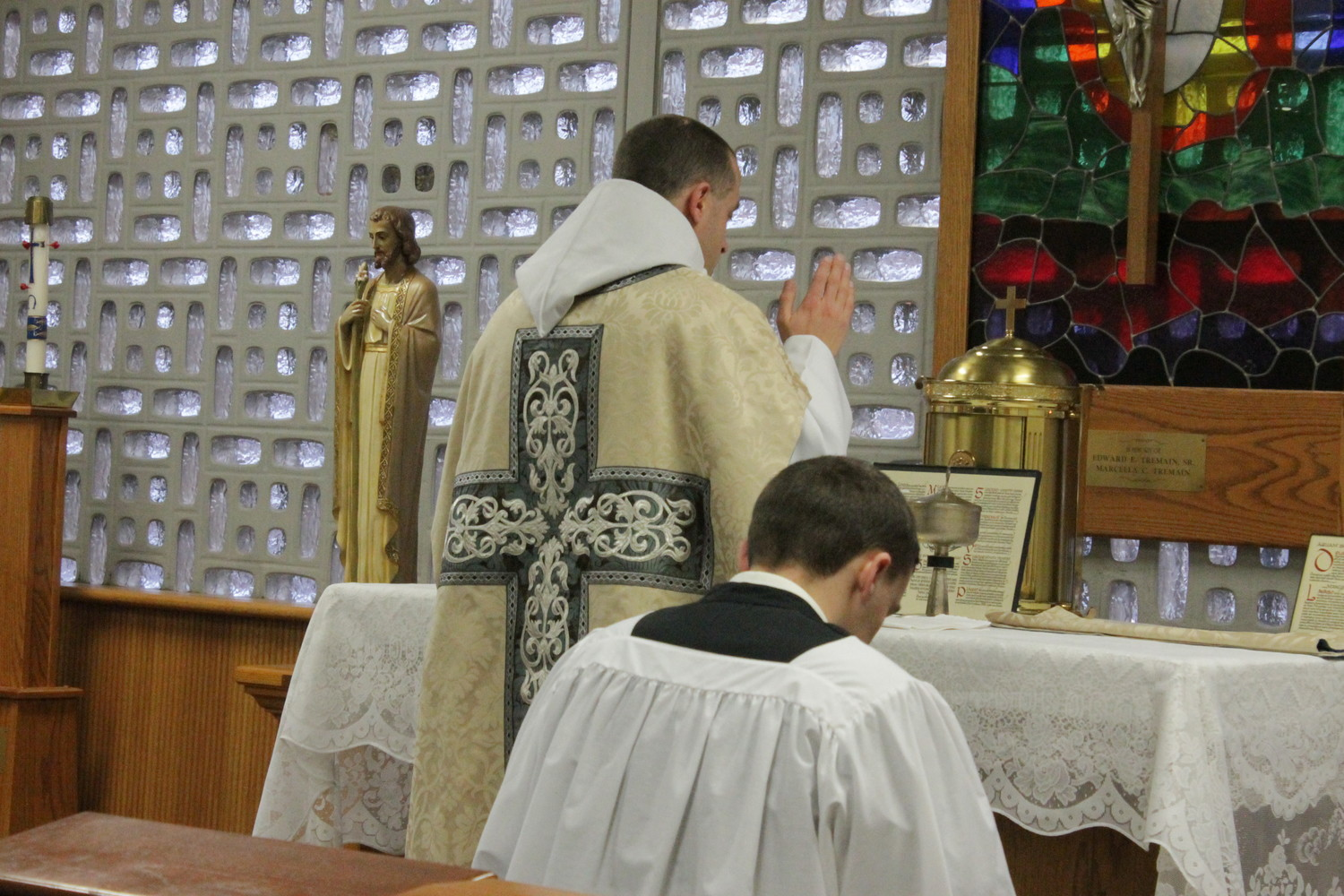 Jefferson City native Father Patrick Carter, standing, a priest of Our Lady of Clear Creek Abbey in Oklahoma, offers Mass in the extraordinary form at Helias Catholic High School in 2016.