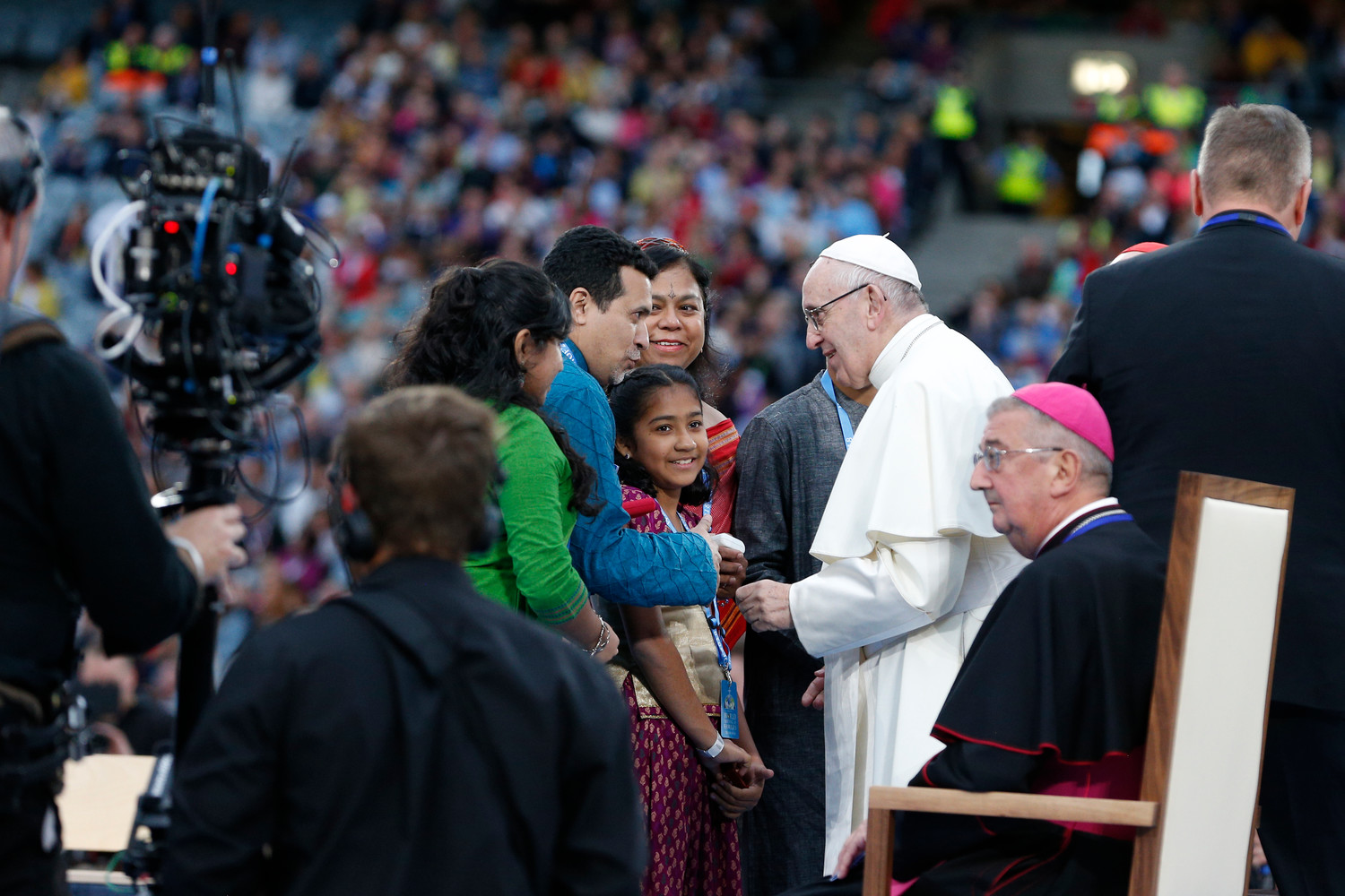 Pope Francis meets with a family that gave testimony during the Festival of Families in Croke Park stadium in Dublin Aug. 25.