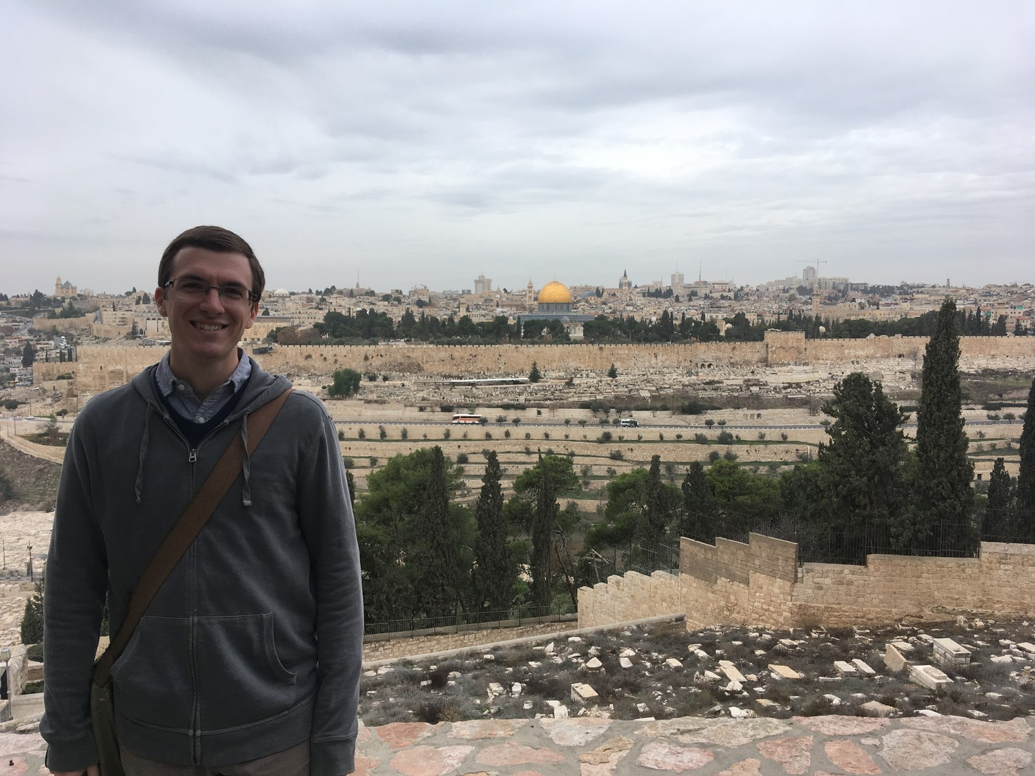 Brad Berhorst pauses for a photo in the Mount of Olives during a pilgrimage to the Holy Land over Christmas 2017 and New Years of 2018. Behind him is the Old City portion of Jerusalem.