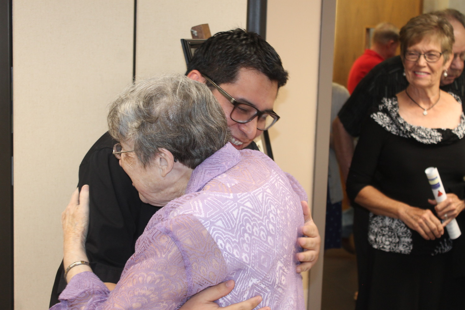 Sister Laura Magowan of the Sisters of Charity of the Incarnate Word greets Father César Anicama at a farewell reception for him at Immaculate Conception parish in Jefferson City.