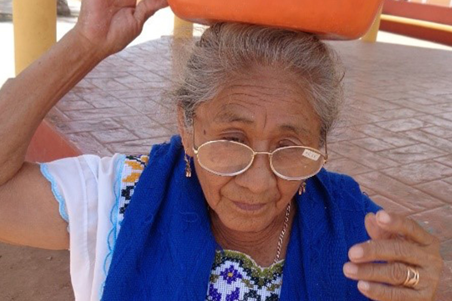 A woman in a village near Merida experiences clearer sight while trying on a pair of