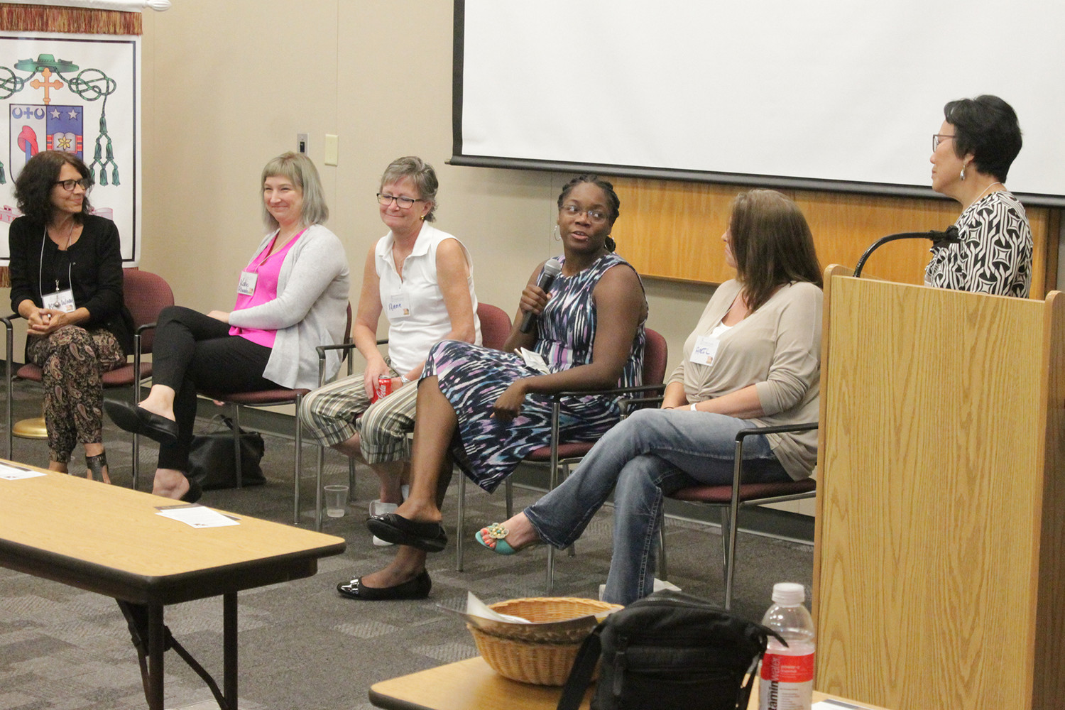 A panel of human trafficking survivors and advocates answers questions during the conference.