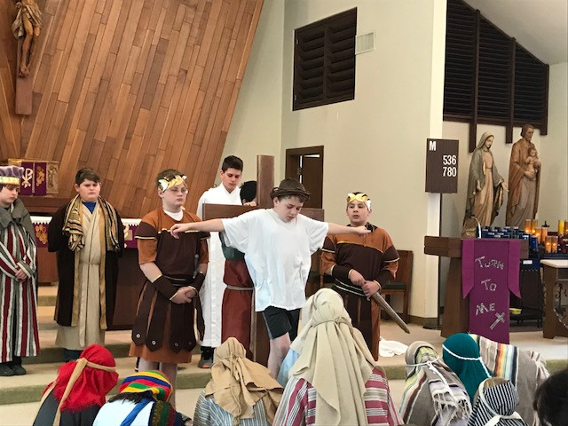 Students of Immaculate Conception School in Macon present the Live Stations of the Cross on March 9, during Lent of this year.