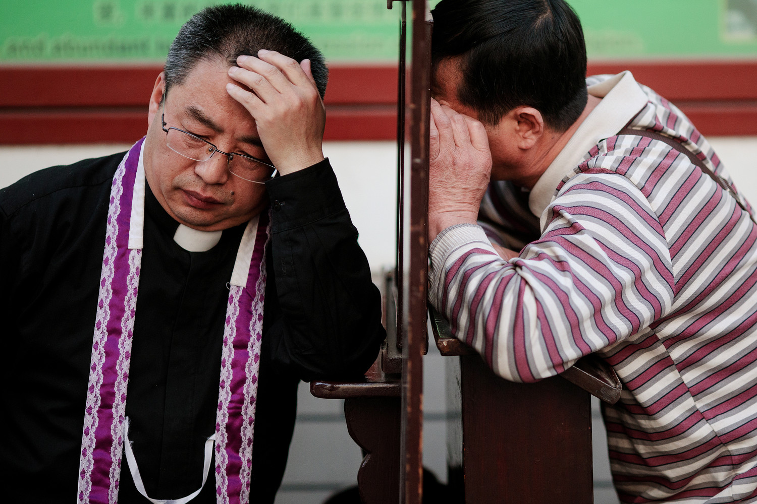 A priest hears confession on Holy Thursday, March 29, at the Cathedral of the Immaculate Conception in Beijing. For the first time in decades, all of the Catholic bishops in China are in full communion with the Pope, the Vatican announced Sept. 22.