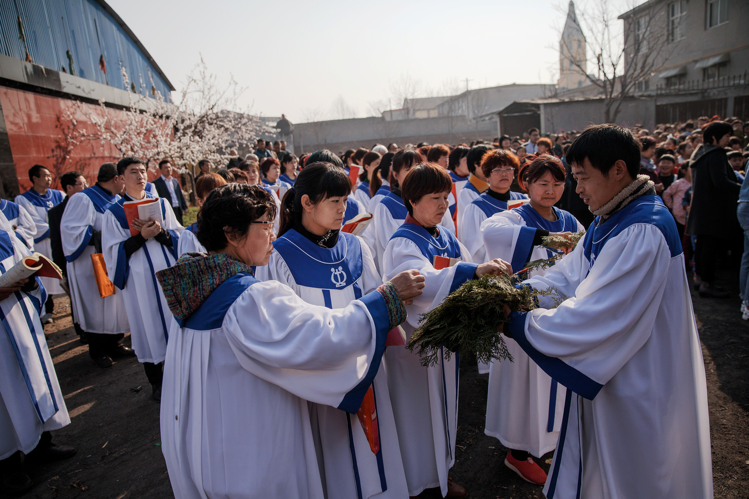 Worshippers prepare for the Palm Sunday procession March 25 outside a Catholic Church in Youtong, China. For the first time in decades, all of the Catholic bishops in China are in full communion with the Pope, the Vatican announced Sept. 22.