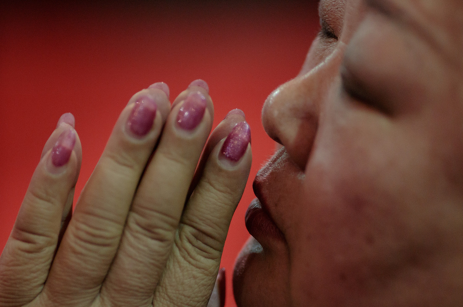 A woman prays during Holy Thursday Mass March 29 at the Cathedral of the Immaculate Conception in Beijing. For the first time in decades, all of the Catholic bishops in China are in full communion with the Pope, the Vatican announced Sept. 22.