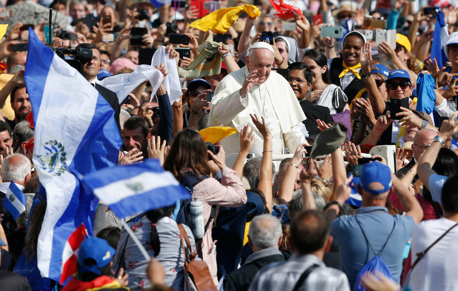 Pope Francis greets the crowd after celebrating the canonization Mass for seven new saints in St. Peter's Square at the Vatican Oct. 14. Among those canonized were Pope St. Paul VI and St. Oscar Romero.