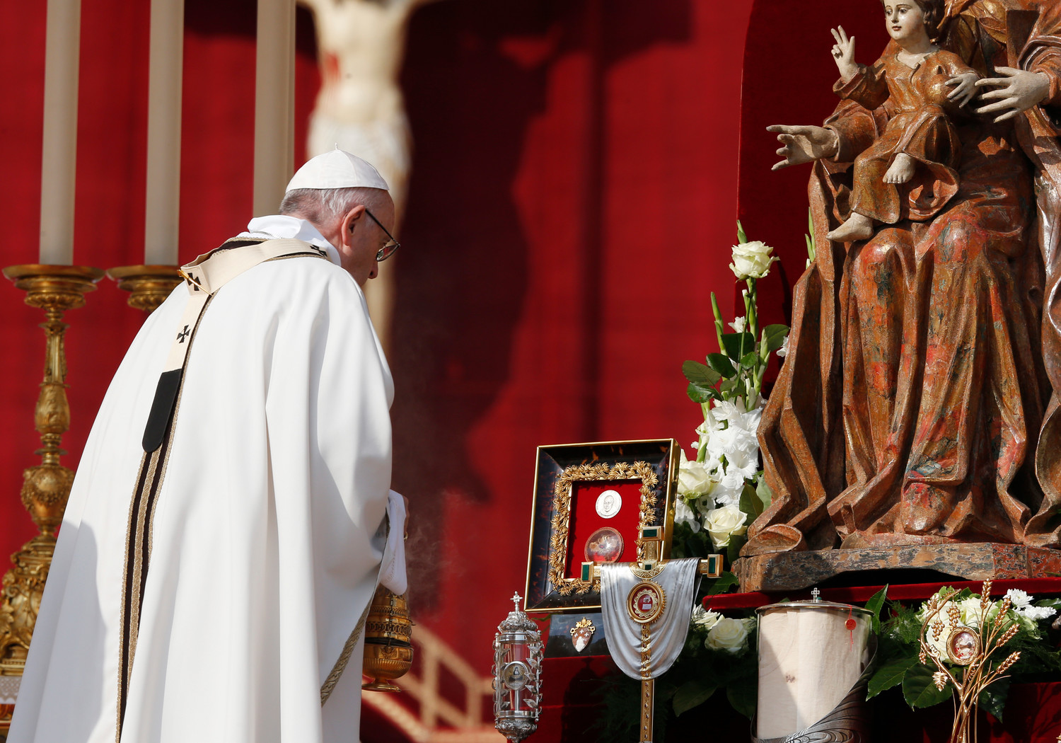 Pope Francis uses incense to venerate relics as he celebrates the canonization Mass for seven new saints in St. Peter's Square at the Vatican Oct. 14. Among the new saints are Pope St. Paul VI and St. Oscar Romero.