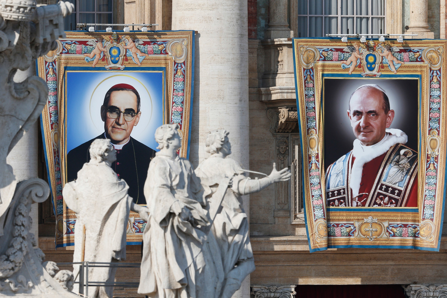 The banners of new saints Oscar Romero and Paul VI hang from the facade of St. Peter's Basilica as Pope Francis celebrates the canonization Mass for seven new saints in St. Peter's Square at the Vatican Oct. 14.