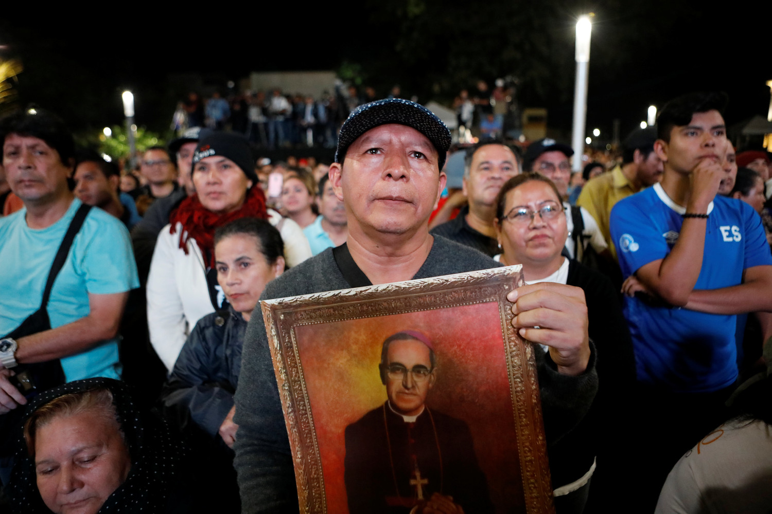 People attend a ceremony at Gerardo Barrios Square in San Salvador, El Salvador, Oct. 14, as Pope Francis celebrates the canonization Mass for St. Oscar Romero and six other new saints in St. Peter's Square at the Vatican.