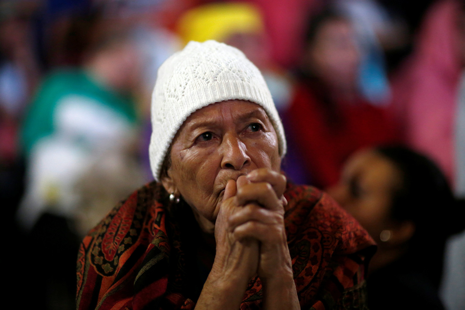 A woman attends a ceremony at Gerardo Barrios Square in San Salvador, El Salvador, Oct. 14, as Pope Francis celebrates the canonization Mass for St. Oscar Romero and six other new saints in St. Peter's Square at the Vatican.