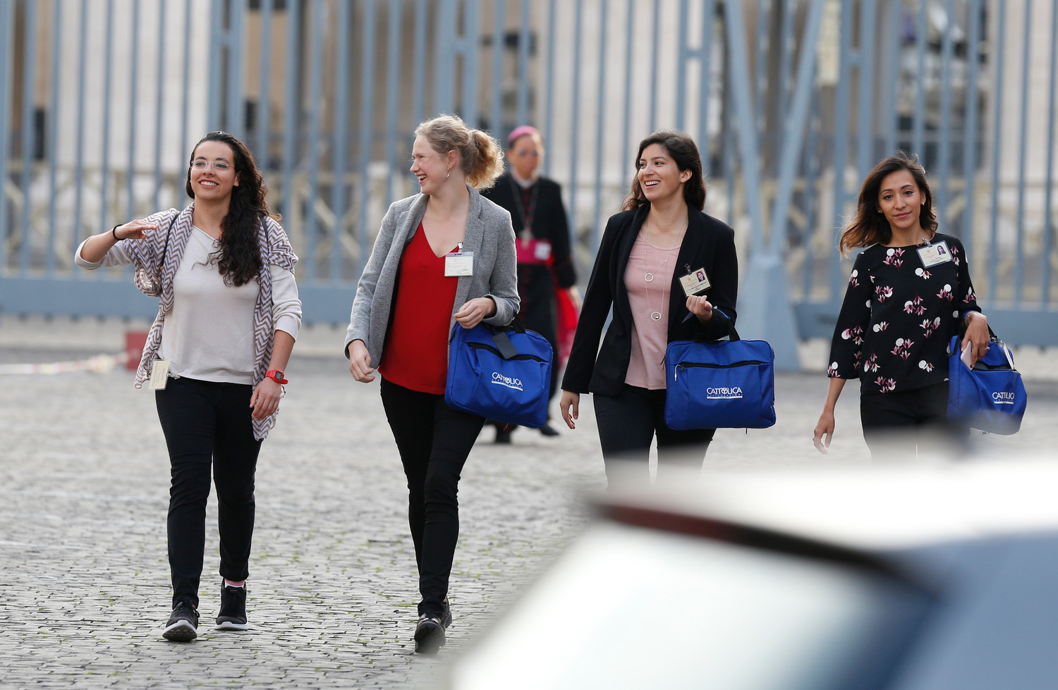 Synod youth delegates arrive for a session of the Synod of Bishops on young people, the faith and vocational discernment at the Vatican Oct. 16.