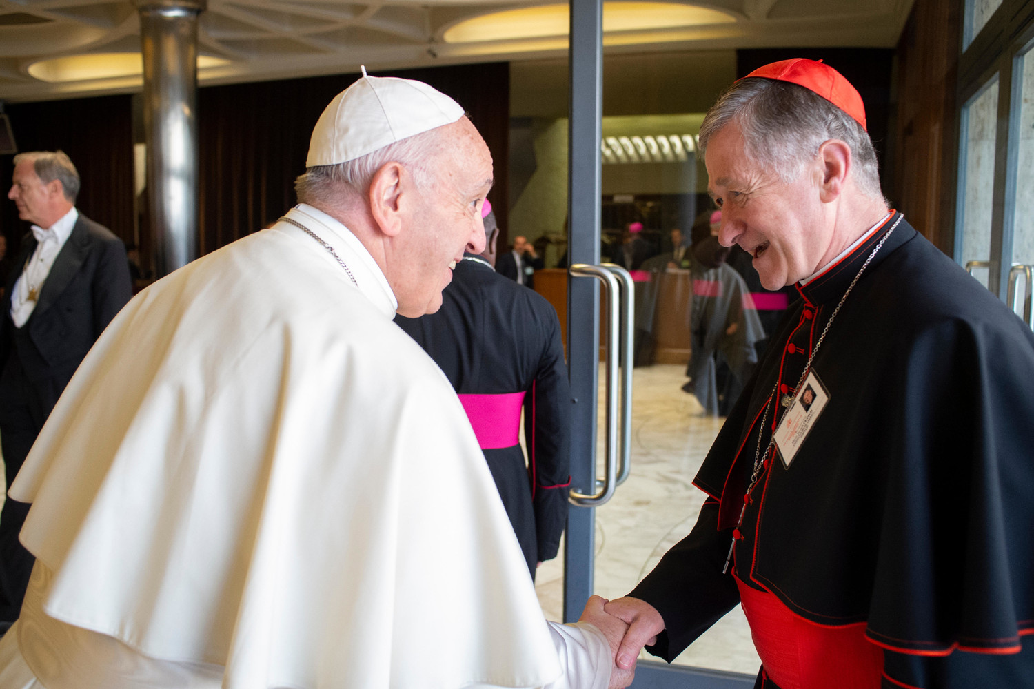 Pope Francis greets Cardinal Blase J. Cupich of Chicago before a session of the Synod of Bishops on young people, the faith and vocational discernment at the Vatican Oct. 16.