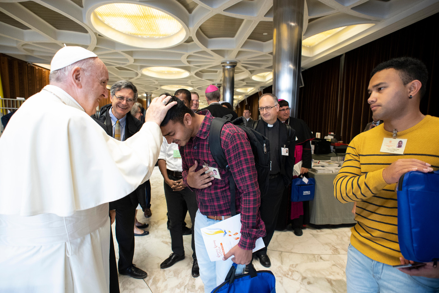 Pope Francis blesses a synod observer before a session of the Synod of Bishops on young people, the faith and vocational discernment at the Vatican Oct. 16.