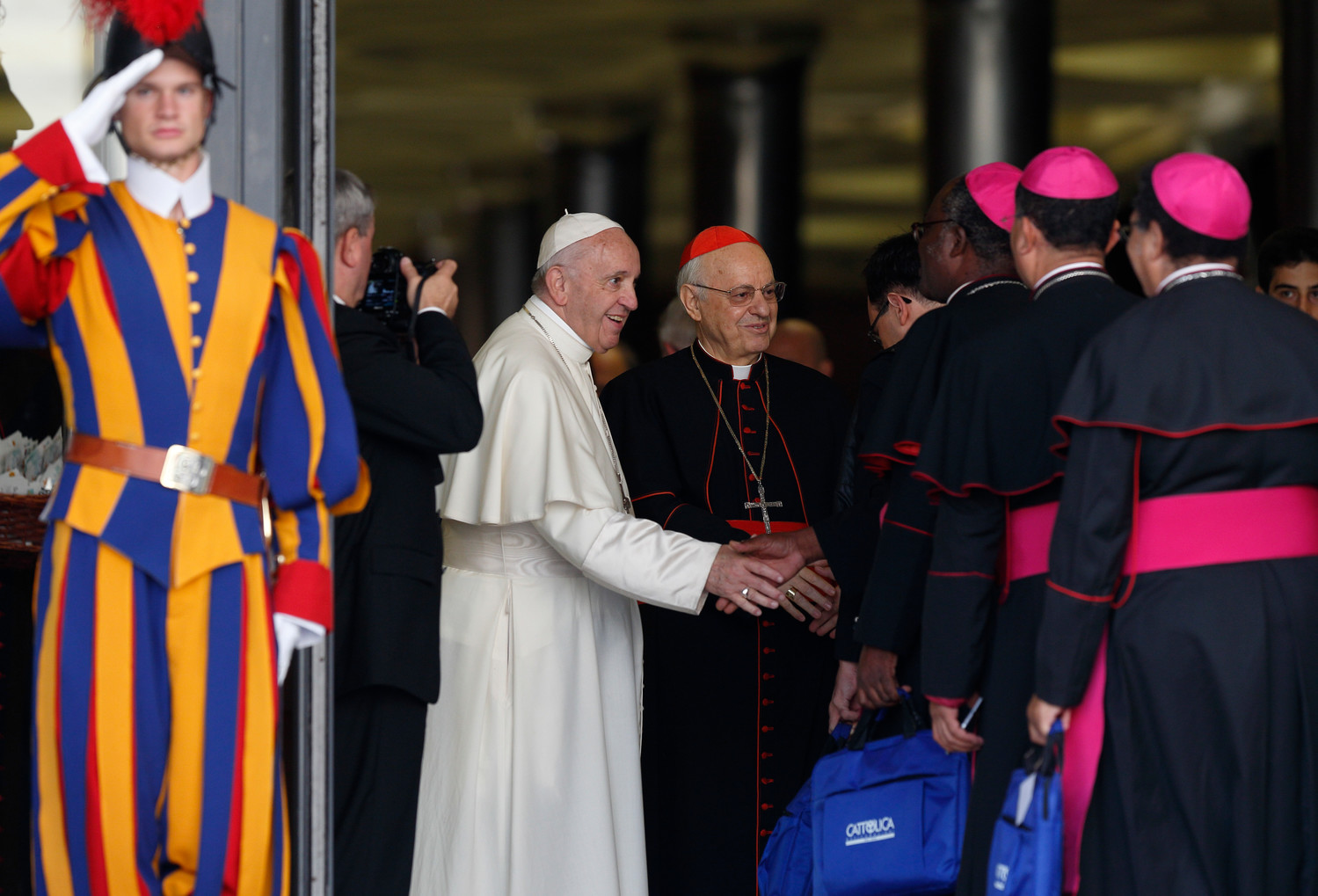 Pope Francis greets bishops as they arrive for a session of the Synod of Bishops on young people, the faith and vocational discernment at the Vatican Oct. 16.