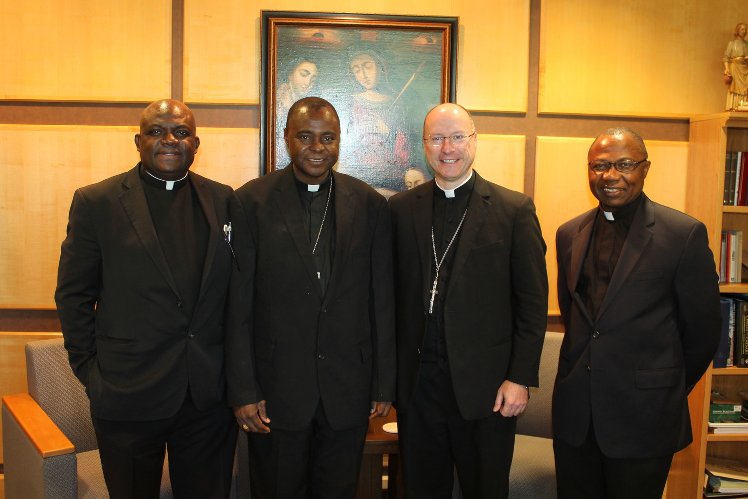 Father Patrick Adejoh, Bishop Anthony Adaji of Idah, Nigeria, Bishop W. Shawn McKnight and Father Joseph Abah meet in Bishop McKnight's office Oct. 11. Fathers Adejoh and Abah, priests of the Idah diocese, are serving in the Jefferson City diocese.