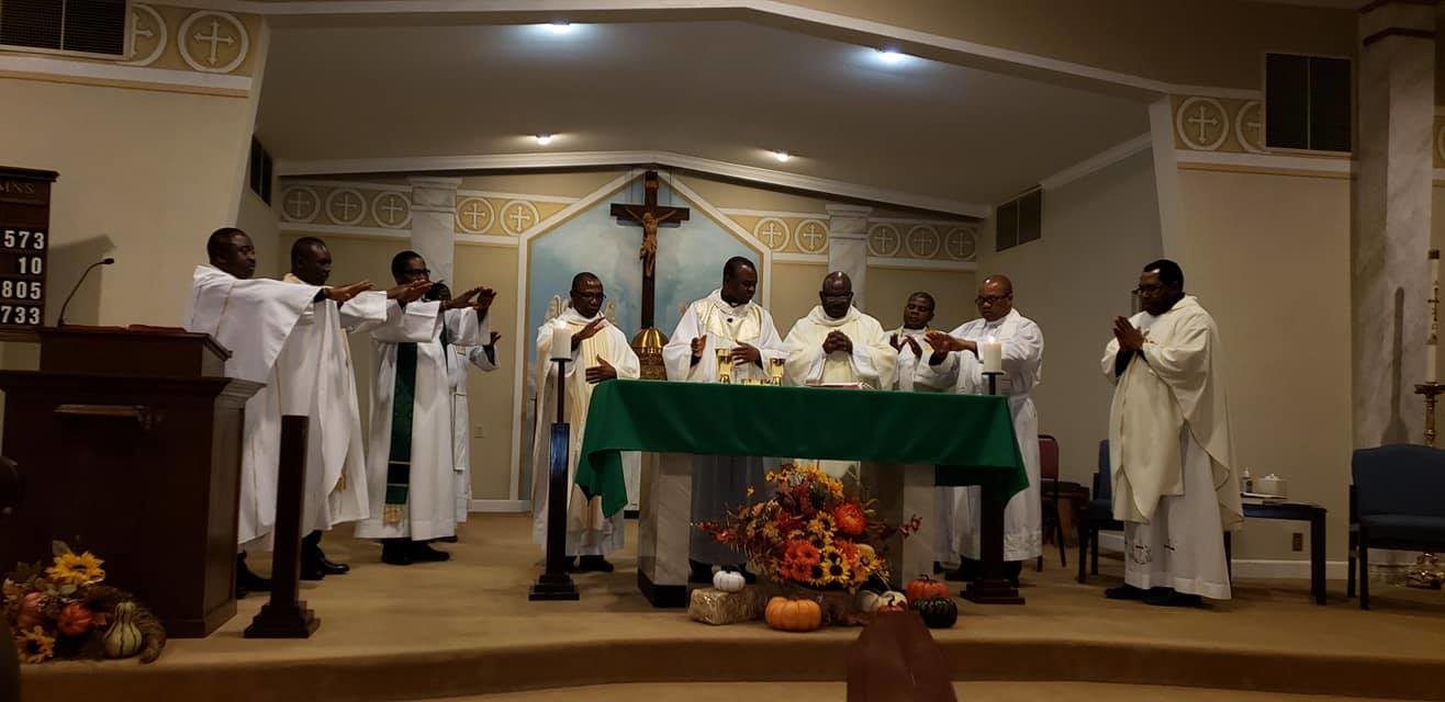 Priests of the Diocese of Idah, Nigeria, who are serving in the United States join Bishop Anthony Adaji for Mass Oct. 11 in St. Peter parish in Fulton.